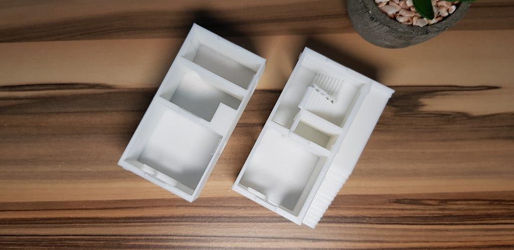 Zwei keine Wohneinheiten aus weißen Kunststoff. Architekturmodell 3D-Druck